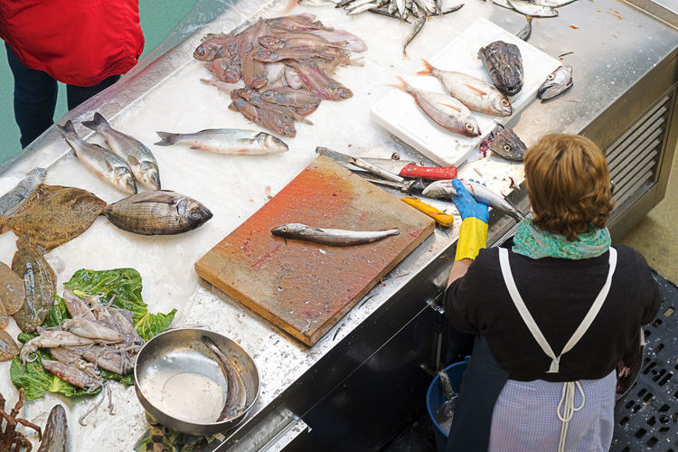 High angle view of woman holding fish in store