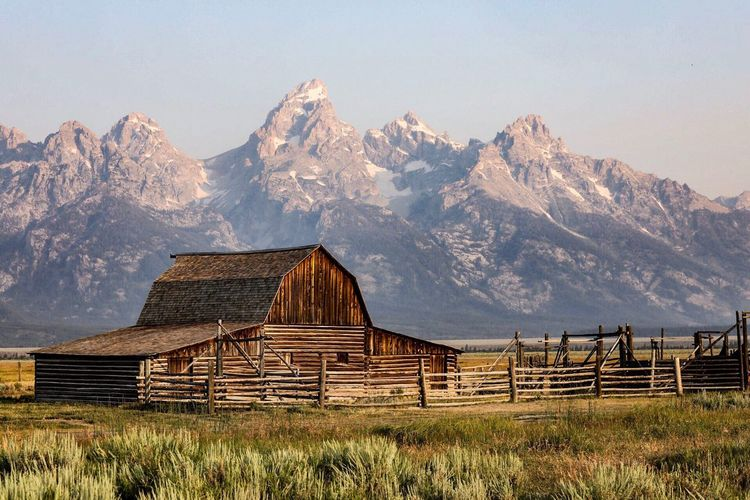 Wood - Material Mountain Range Landscape No People Outdoors Beauty In Nature Grass Barn Field Mormon Row Mountain Scenics