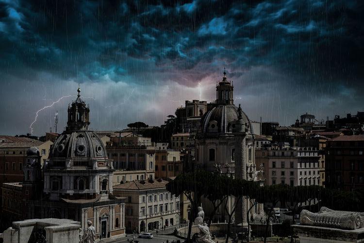 Townscape against cloudy sky during rainy season