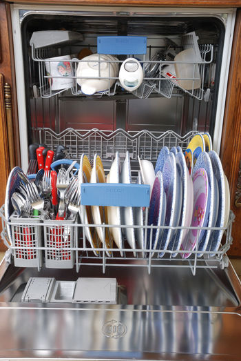 Close-up of dishwasher at home