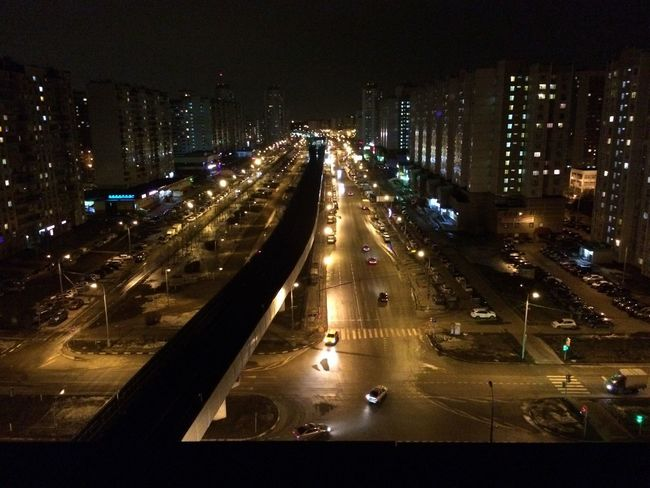 Illuminated Night Transportation Architecture Road Traffic Built Structure Land Vehicle Motion No People Cityscape High Street Mode Of Transport High Angle View Street Light Speed City Building Exterior Light Trail Outdoors