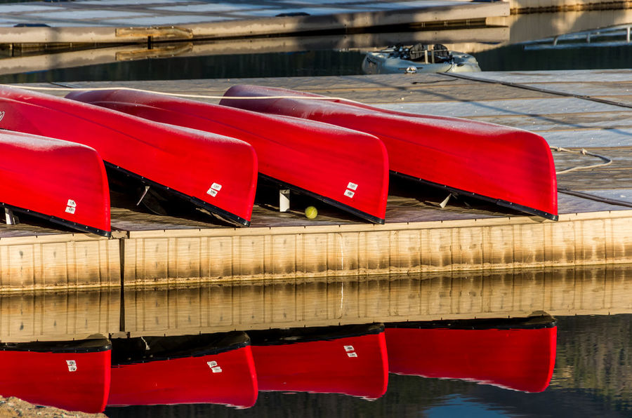 Boats on Dock, Lake Dillon Frisco Colorado Lake Dillon Frisco, CO Reflection Water Red In A Row Lake Waterfront Outdoors Canoes On Lake Boat Dock
