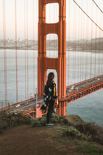 Lonely woman California dreaming. Cityscape Golden Gate Bridge Landscape Photography Skyline Standing Travel Photography USA Architecture Bridge Bridge - Man Made Structure Brunette Folk Full Length One Person Orange Color People Real People Sea Sea And Sky Skyline USA Sunset Suspension Bridge Travel Destinations View From Above Young Woman California Dreamin Visual Creativity Adventures In The City The Traveler - 2018 EyeEm Awards #urbanana: The Urban Playground A New Beginning Capture Tomorrow It's About The Journey Moments Of Happiness 2018 In One Photograph Streetwise Photography International Women's Day 2019