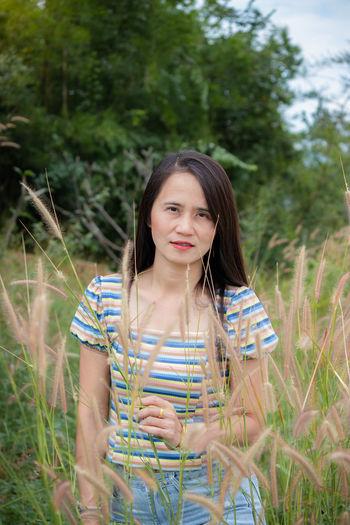Portrait of teenage girl smiling on field