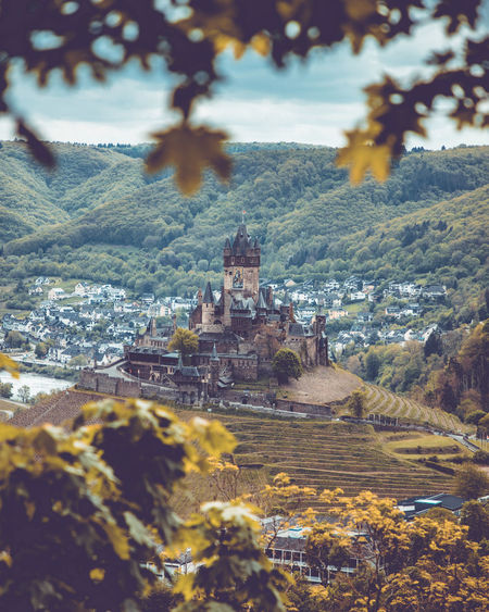 Areal view to city and castle of Cochem, Rheinland-Pfalz, Germany, May 2019 Germany Mosel Mosel Valley Architecture Built Structure Tree Building Mountain Building Exterior Nature Plant Day History Travel Destinations City The Past Outdoors No People Environment Residential District Landscape Tower Castle Cochem Castle Focus On Background Tree Leaf High Angle View Cityscape TOWNSCAPE