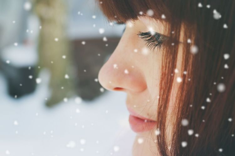 Close-up of young woman in snow