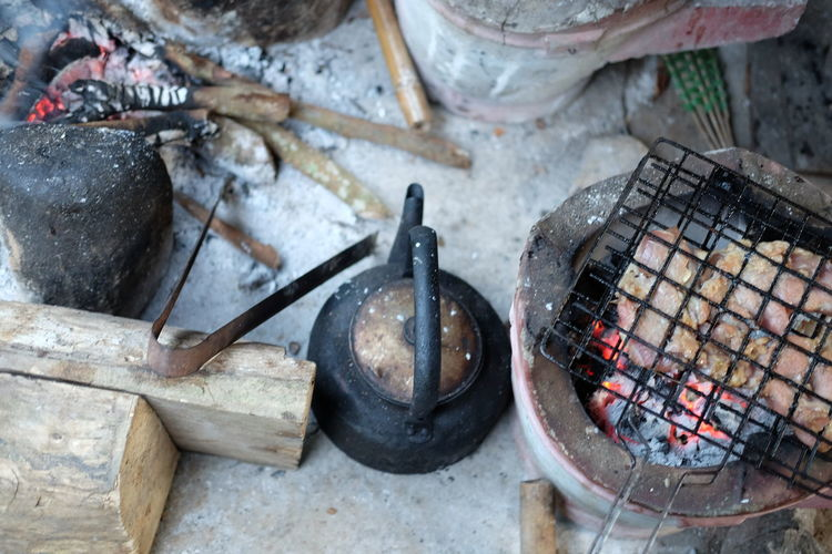 High angle view of food being prepared on wood burning stove