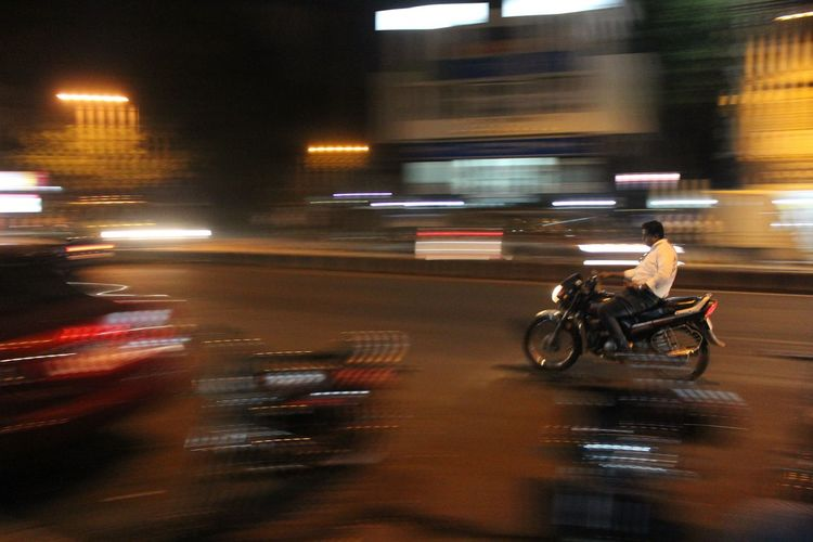 Phoneaddict On The Move Speed Blurred Motion Mode Of Transport Motion Transportation Blurred Motion Land Vehicle On The Move Speed Illuminated Road Long Exposure Street Travel City Life City Bicycle Night Light Trail Riding Journey