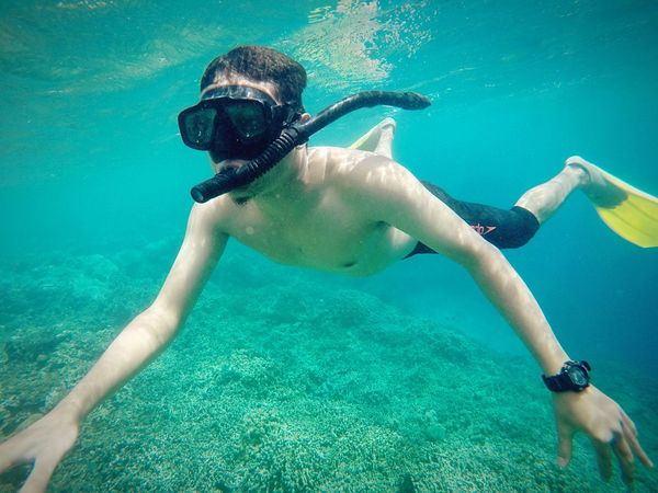 Underwater UnderSea Sea One Person Swimming People Scuba Diving Mid Adult Snorkeling Full Length Water Adventure Vacations Looking At Camera Portrait Adult Lifestyles Human Body Part EyEmNewHere Menjanganisland Snorkeling Outdoors Day INDONESIA Indonesia_photography Lost In The Landscape