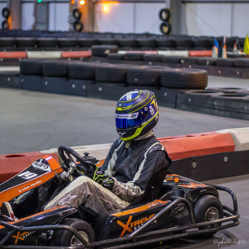 Competition Crash Helmet Day Focus On Foreground Gokart Gokart Racing Gokarting Headwear Helmet Land Vehicle Leisure Activity Men Mode Of Transportation Motor Racing Track Motorcycle One Person Outdoors Protective Sportswear Real People Riding Sitting Sport Sports Helmet Sports Race Transportation