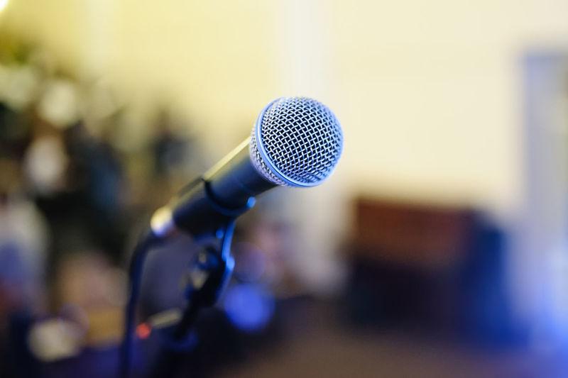 Close-Up Of Microphone In Auditorium