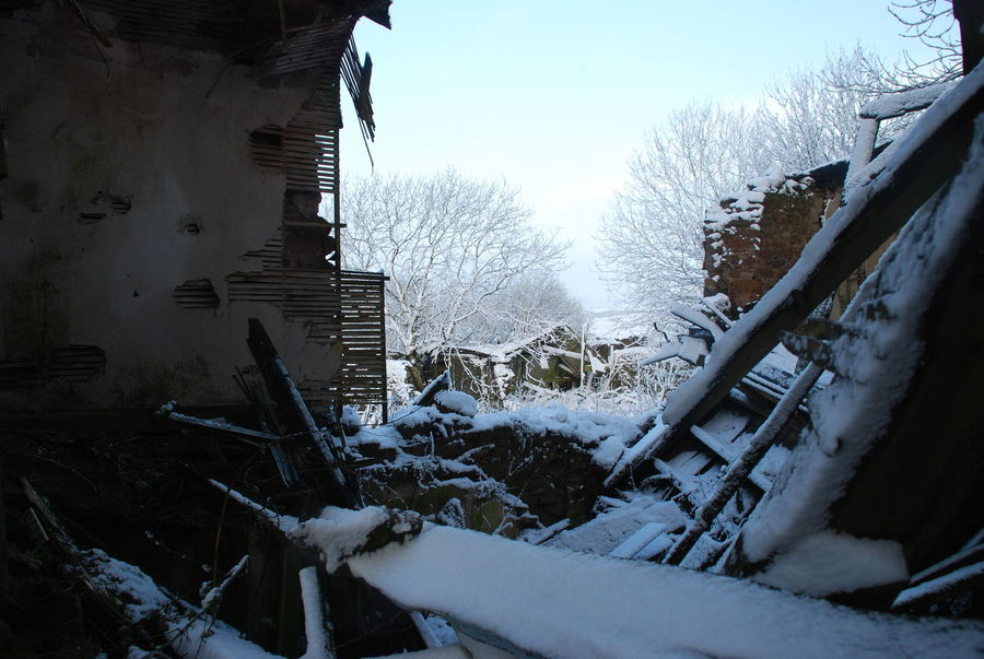 Old Farmhouse Architecture Bare Tree Beauty In Nature Building Exterior Built Structure Cold Temperature Day Frozen Inside Out Maybe Nature No People Old Walls Outdoors Ruined Building Sky Snow Snowdrift Tree Weather Winter