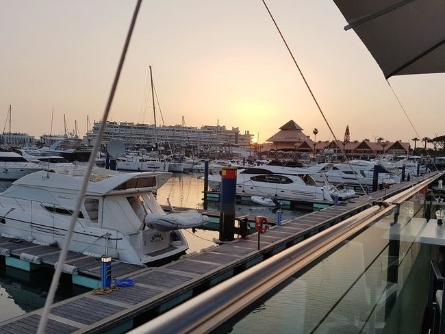 sunset whilst having food City Sunset Business Finance And Industry Water Sea Sky Boat Nautical Vessel Water Vehicle