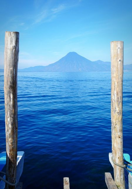 calm..lago atitlan Traveling Travel Beautiful Nature Beautiful Day Lago Lake Life Lakescape Panajachel  Relaxing Relaxing Time Reflection Reflection Lake Sea Clear Sky Blue Mountain Beach Sky Whitewashed Horizon Over Water Ocean Wave Surf Pier Calm Shore Seascape Surfer Tide Coastline