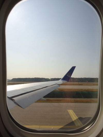 Plane Air Vehicle Aircraft Wing Airplane Airplane Wing Airport Clear Sky Close-up Commercial Airplane Day Flying Indoors  Journey Mode Of Transport No People Runway Sky Transportation Travel Water Window