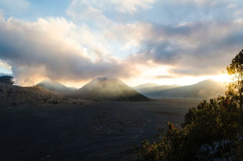 Beautiful sunrise scenery Mount Bromo. Traveller Travel Photography Travelphotography Valcano Bromo Mountain EyeEm Selects Bromo Tengger Semeru National Park Mountain Cloud - Sky Sky Scenics - Nature Beauty In Nature Tranquil Scene Non-urban Scene Environment Land Idyllic Smoke - Physical Structure Landscape Volcano Tranquility Mountain Range Nature No People Plant Sunset Outdoors