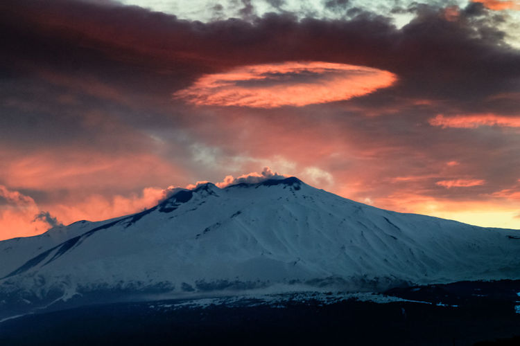Sky Beauty In Nature Scenics - Nature Cloud - Sky Mountain Sunset Snow Cold Temperature Tranquil Scene Winter Tranquility Snowcapped Mountain Idyllic Landscape Non-urban Scene Environment Nature No People Volcano Mountain Peak