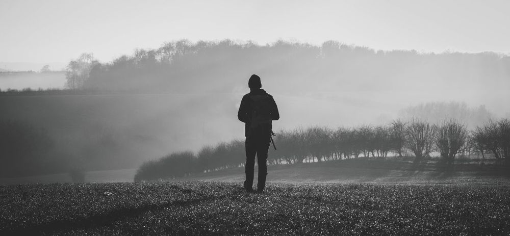 Fog Foggy Real People One Person Nature Rear View Field Standing Day Beauty In Nature Tranquility Landscape Outdoors Men Winter Hazy  Scenics Walk Field Landscape_photography Finding New Frontiers
