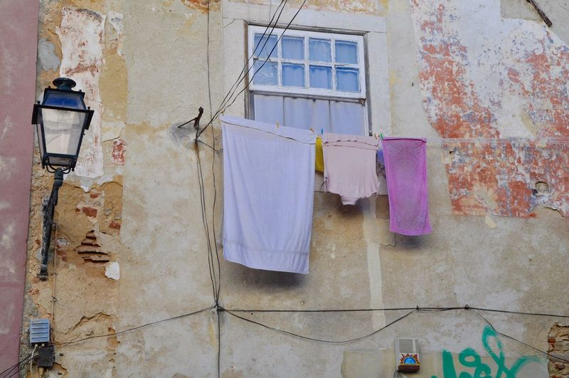 Low angle view of clothesline on building