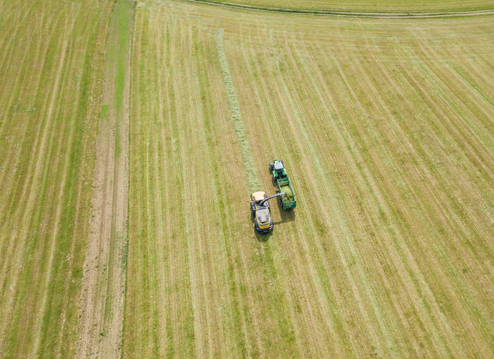 Aerial View Agricultural Equipment Agricultural Machinery Agriculture Crop  Day Environment Farm Field Green Color Growth High Angle View Land Land Vehicle Landscape Machinery No People Outdoors Plant Ripe Rural Scene Tractor Transportation
