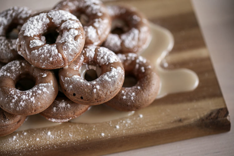 Close-Up Of Donuts On Cutting Board
