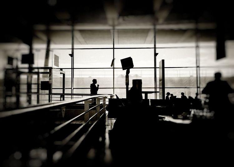 Silhouette people walking on airport