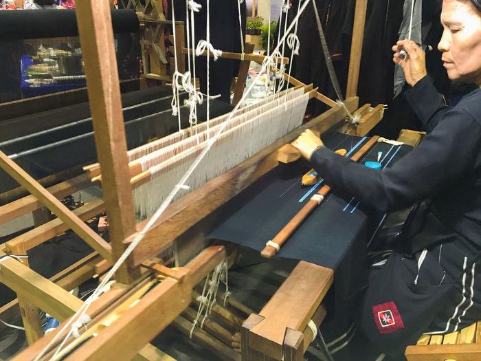 Woman working on handloom