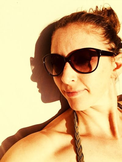 Shadows & Lights Shadow Glasses Fashion Sunglasses Young Adult Headshot Portrait One Person Front View Real People Beautiful Woman Adult