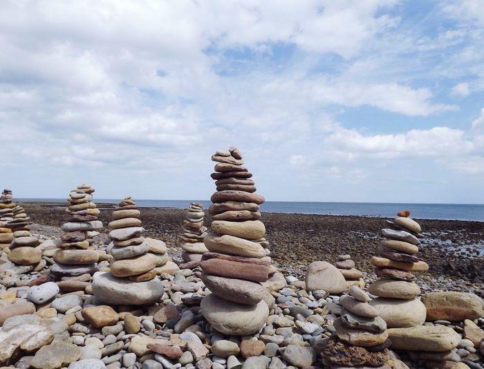 Stack Of Pebble Stones On Beach
