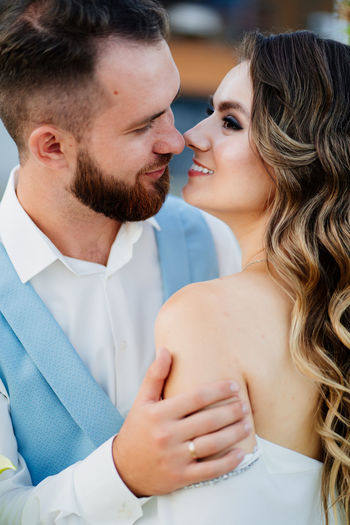 Close-up newlywed couple embracing outdoors