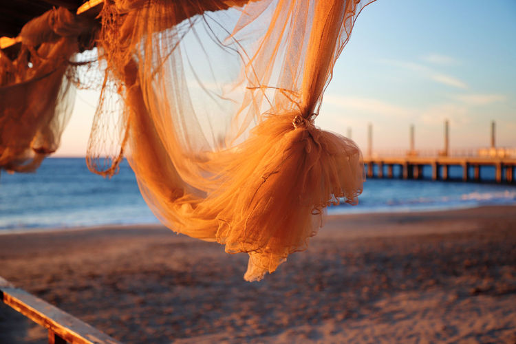 Alassio Liguria Italy Pier Water Scenics Sea Beach Beachphotography Sand Morning Light Beautiful Good Morning Sunrise Land Sky Nature Outdoors Selective Focus Fisher Net Decoration Shells Seashell Atmospheric Mood