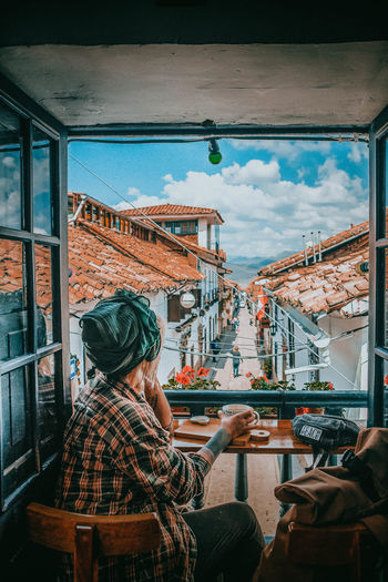 Chai break in Cusco City City Life Cityscape Cusco Peru Postcard Tea Travel Travel Photography Traveling Adult Architecture Day Food And Drink Headshot Indoors  Interior Design Lifestyles Market One Person Real People Sitting Sky Travel Destinations Women The Traveler - 2018 EyeEm Awards #urbanana: The Urban Playground