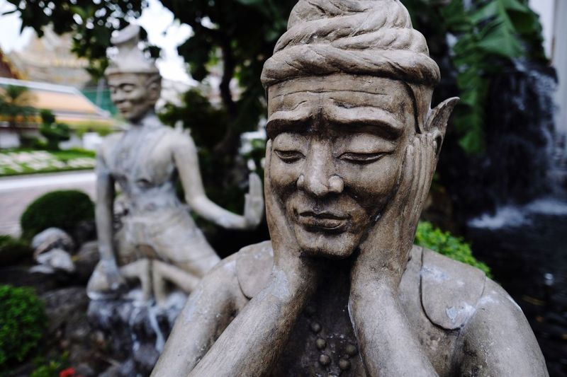 EyeEm Selects Statue Sculpture Human Representation Art And Craft Male Likeness No People Outdoors Focus On Foreground Day Tree Close-up Architecture Statue Travel Place Of Worship Travel Destinations Spirituality Temple In Thailand