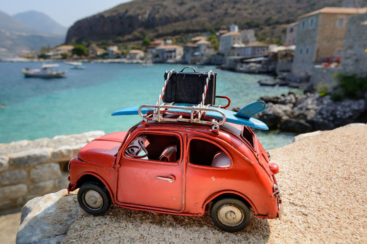 Close-up of vintage car against sea