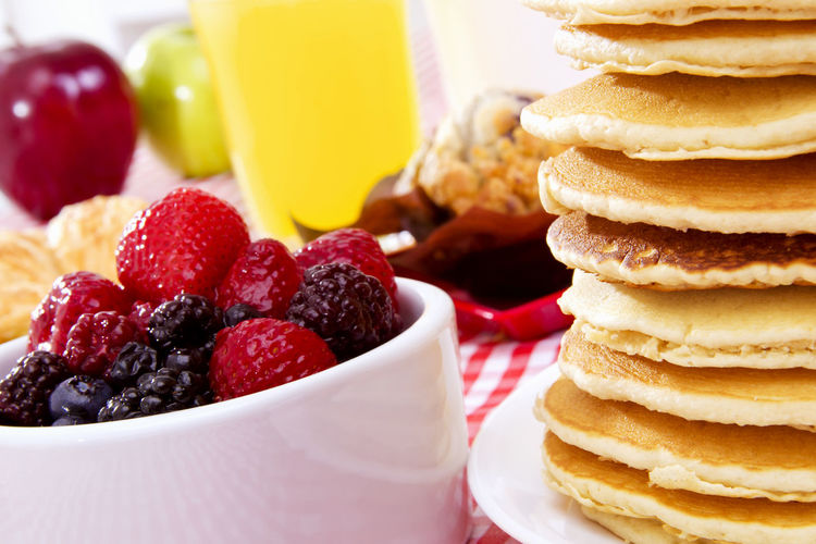 Close-Up Of Berry Fruits With Pancakes In Plate On Table