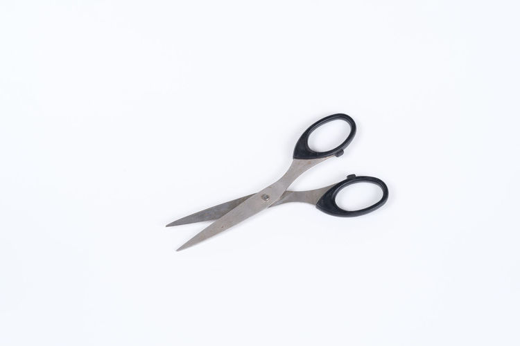 Background Clean Cut Cutting Equipment Paper Rock Scissor Used White White Background Studio Shot Scissors Indoors  Copy Space No People Single Object Close-up Cut Out Metal Still Life Work Tool Sharp Design Simplicity Directly Above Shape High Angle View Tool Steel