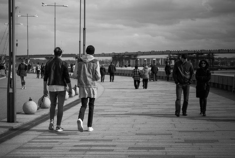 Group Of People Walking On Pathway