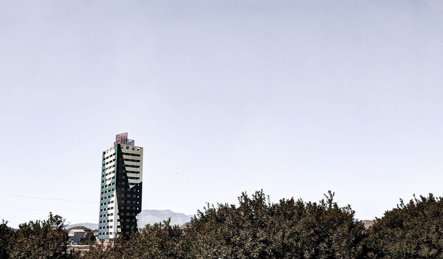 An unusual tower Fire Tower Modern Architecture SPAIN Spanish Arquitecture Bushes Tree Modern City Sky Architecture Building Exterior Skyscraper Tower Spire  Tall Cityscape