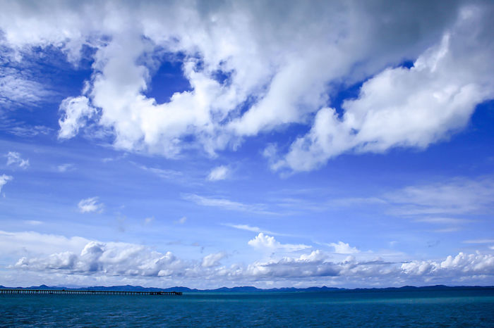 Sea View Clouds in the Sky on a Bright Day Beauty In Nature Blue Cloud - Sky Day Horizon Horizon Over Water Idyllic Land Landscape Landscape Sea Nature No People Non-urban Scene Outdoors Scenics - Nature Sea Sky Tranquil Scene Tranquility Water Waterfront
