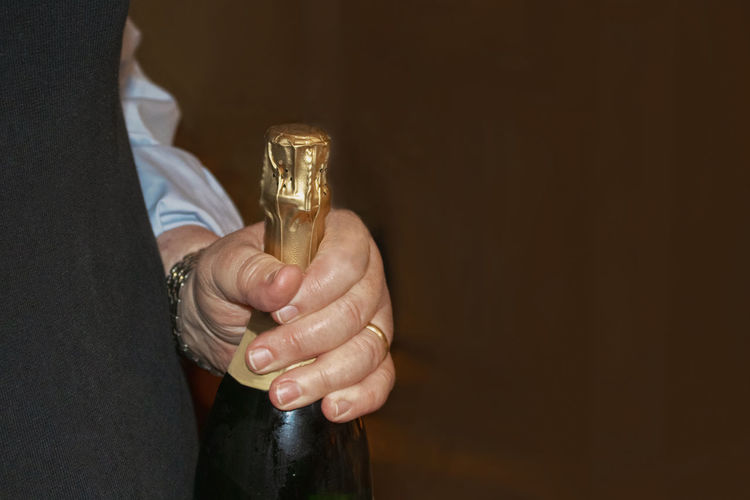 Close-up of man holding drink