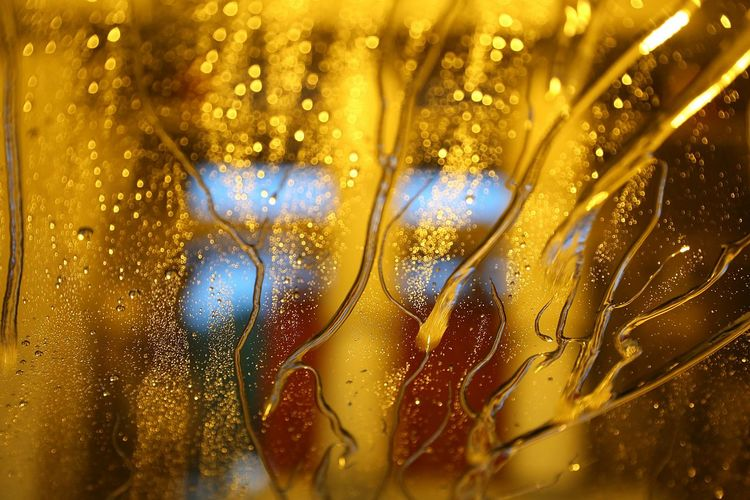 Close-Up Of Wet Car Window At Night