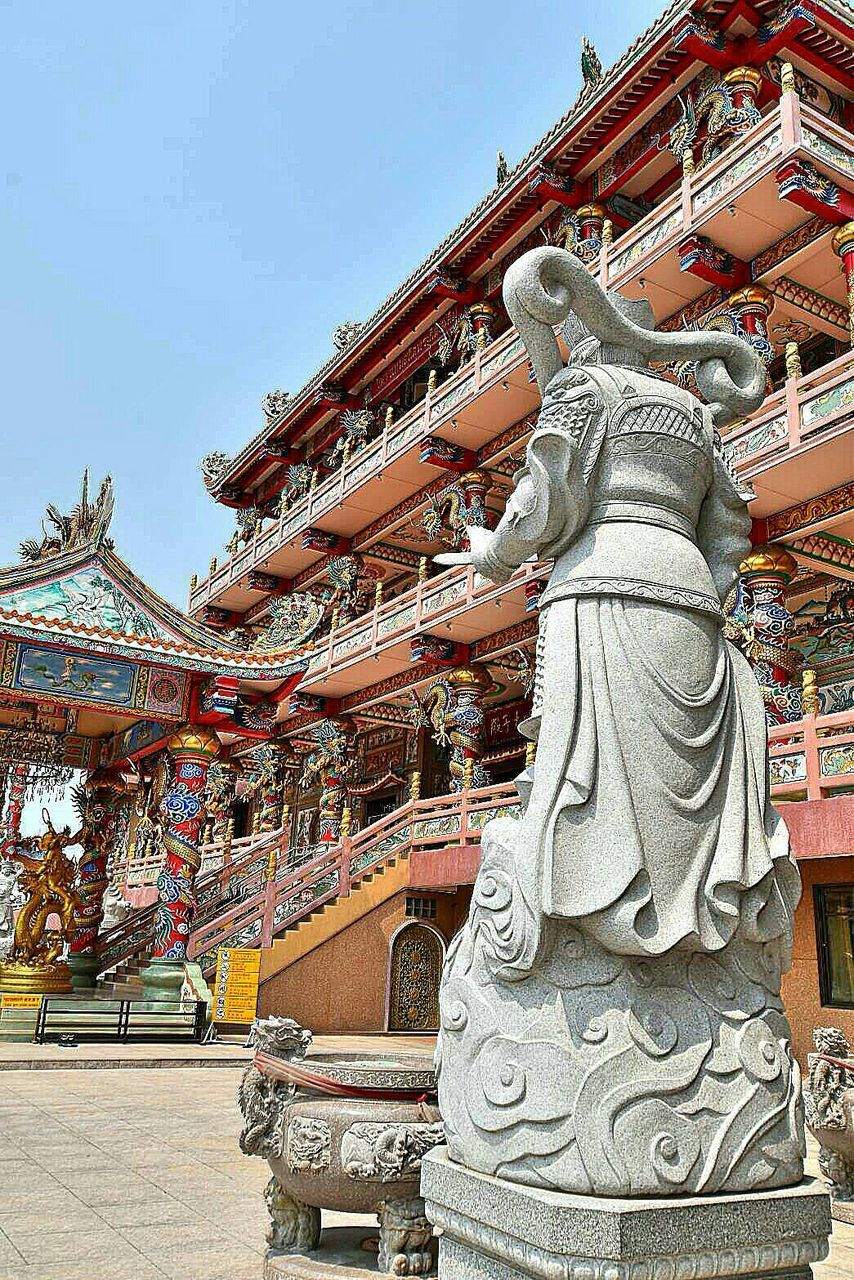 religion, architecture, pagoda, travel destinations, spirituality, history, place of worship, built structure, statue, building exterior, sky, ancient, gold, outdoors, day, no people, low angle view, sculpture, royalty