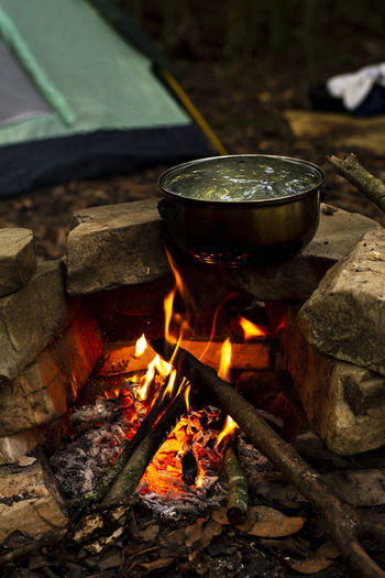 Water boiling on utensil over fire