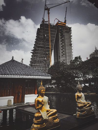 Religion vs Science Buddhist Temple Temple Buddha Cloud - Sky Sky Water Celebration Day Outdoors No People Built Structure Building Exterior Architecture Moving Around Rome Modern Workplace Culture The Street Photographer - 2018 EyeEm Awards