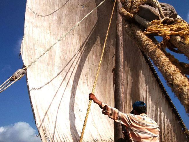 Fishing Net Nautical Vessel OutdoorsEnjoy The New Normal Day Rock Climbing Rigging Adults Only Nature Sailing Ship One Person People Adult Only Men One Man Only Sailing Ship Fighter Plane Blue Heat - Temperature Low Angle View Rear View Real People Travel Destinations Illuminated Building Exterior