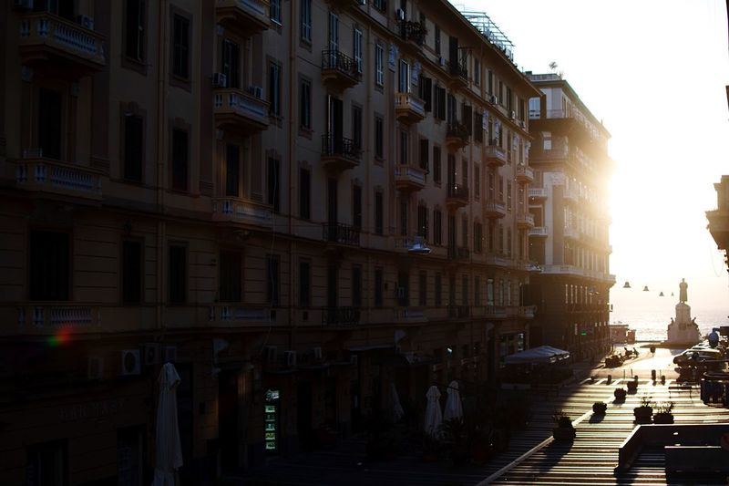 Houses of the rising sun. Street Photography Italy Architecture Building Exterior City Built Structure Street Building Sky Nature Sunlight No People Residential District City Street Outdoors City Life Lens Flare Window
