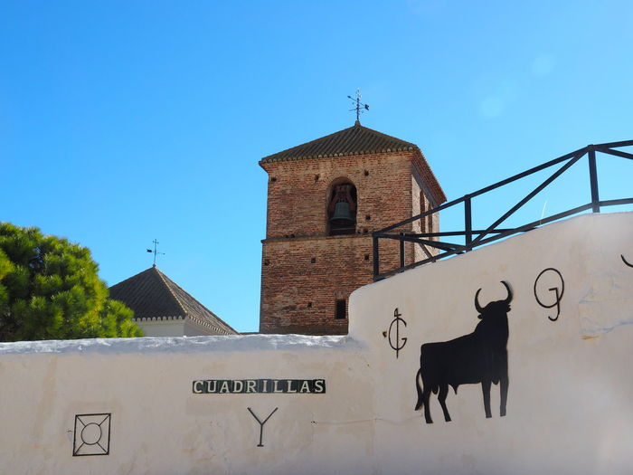 Architecture Built Structure Building Exterior Sky Building Clear Sky Place Of Worship Text Blue Day Nature Copy Space No People Outdoors Arena Museum Bull Mijas Pueblo Mijas SPAIN