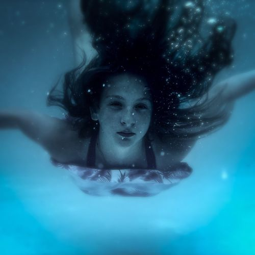 She dreams underwater! Happy new year EyeEm fam! Bubbles Pretty Girl Mermaid Blue Water Hair Hair Underwater Girl Underwater Teen Girl Girl Underwater One Person Young Adult Water Portrait Women Swimming Pool Beauty