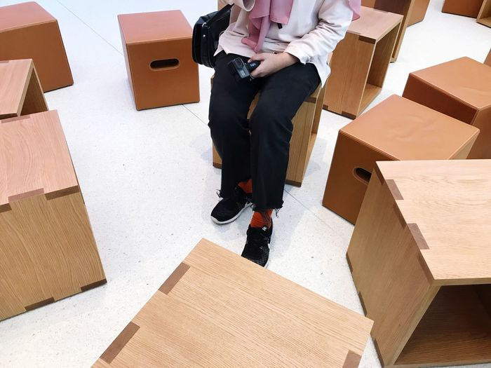 EyeEm Selects Cardboard Box Low Section Box - Container Packing Stack Cardboard One Person Indoors  Moving House Steps And Staircases Large Group Of Objects Human Leg One Man Only People Young Adult Business Sitting Adult Human Body Part Day