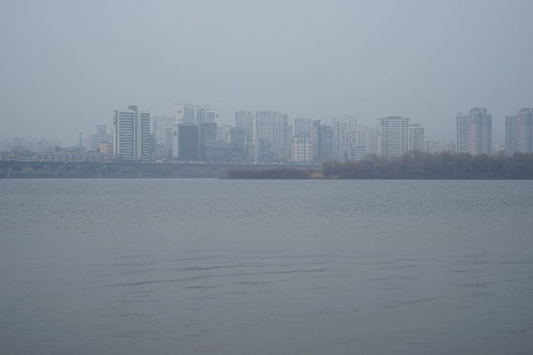 Air Pollution Cityscape Han River Architecture Building Exterior Built Structure City Cityscape Day Downtown District Fog Gloomy Day Gray Modern Nature No People Outdoors Sky Skyscraper Smog Urban Skyline Water Waterfront